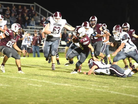 Stuarts Draft's Blake Roach stays on his feet as he works through the Luray defense Friday.