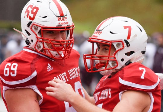 Andrew VanErp (right) and Karl Rude celebrate a touchdown against Augsburg Saturday, Oct. 5, 2019, at Clemens Stadium.