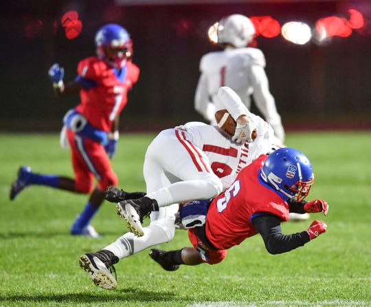 Apollo's Michael Gravelle tackles Blake Schoolmeester of Willmar during the first half of the Friday, Oct. 4, 2019, game at Apollo High School in St. Cloud.