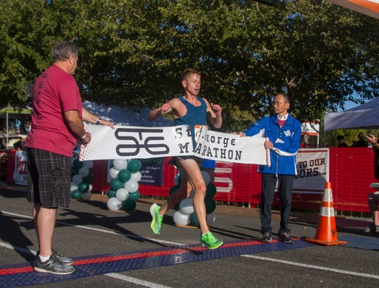 Jonathan Kotter, from Holladay, finishes first in the St. George Marathon Saturday, Oct. 5, 2019.