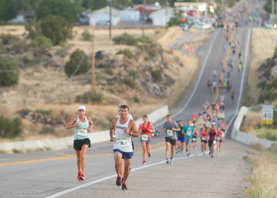 Runners compete in the St. George Marathon Saturday, Oct. 5, 2019.