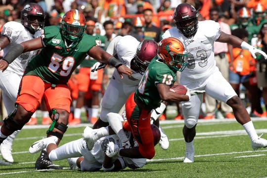 Florida A&M Rattlers running back Bishop Bonnett (13) reaches for a larger gain on the play. The Rattlers hosted the North Carolina Central Eagles for their 2019 homecoming game Saturday, Oct. 5, 2019.