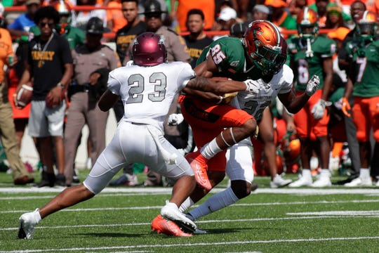 FAMU wide receiver David Manigo (85) forces his way though two defenders. The Rattlers hosted the North Carolina Central Eagles for their 2019 homecoming game Saturday, Oct. 5, 2019.