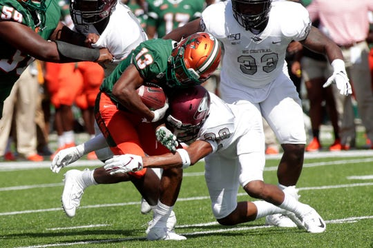 Florida A&M Rattlers running back Bishop Bonnett (13) gets tackled by a defender. The Rattlers hosted the North Carolina Central Eagles for their 2019 homecoming game Saturday, Oct. 5, 2019.