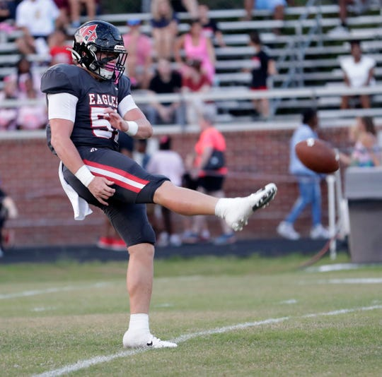 NFC linebacker Jaxon Giles punts for the Eagles during a loss to Florida High.