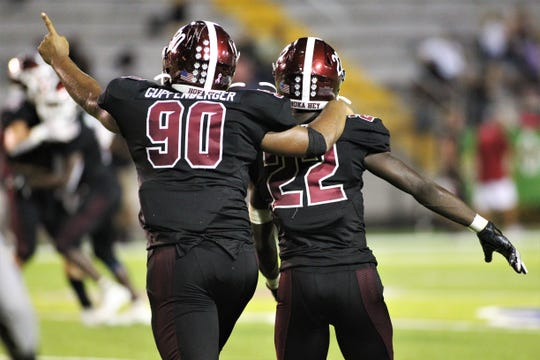 Chiles' Dominic Guppenberger (90) celebrates with LaCorey Levens (22) after Levens' third interception as Lincoln beat Chiles 26-14 at Gene Cox Stadium on Friday, Oct. 4, 2019.