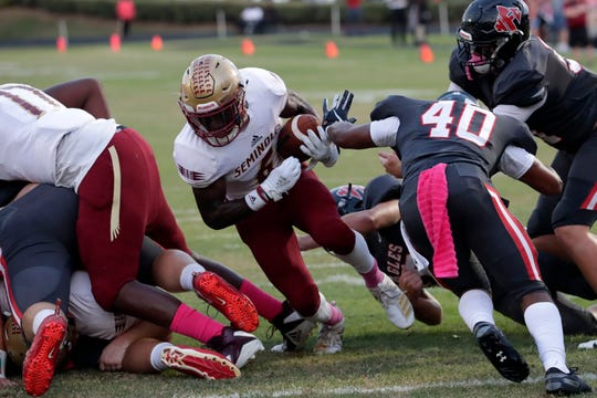 Florida High running back Alfred Menjor dives to the end zone as the Seminoles beat NFC on Oct. 4, 2019.
