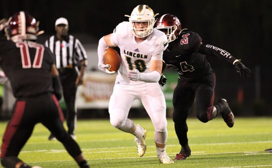 Lincoln senior tight end Sage Ennis runs after a catch as Lincoln beat Chiles 26-14 at Gene Cox Stadium on Friday, Oct. 4, 2019.