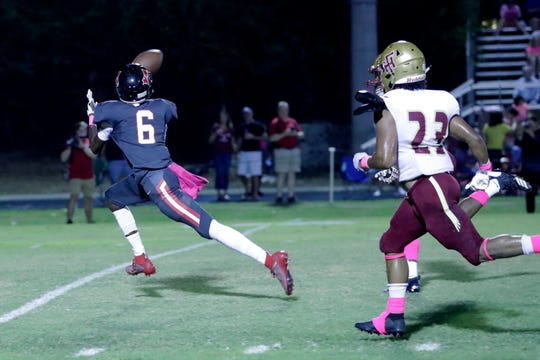 NFC receiver Traylon Ray (6) catches a deep pass for a 52-yard touchdown, but the Eagles fell 60-13 to Florida High on Oct. 4, 2019.