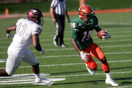 Florida A&M Rattlers wide receiver Xavier Smith (19) runs the ball to the end zone. The Rattlers beat the Eagles 28-21 Saturday, Oct. 5, 2019.