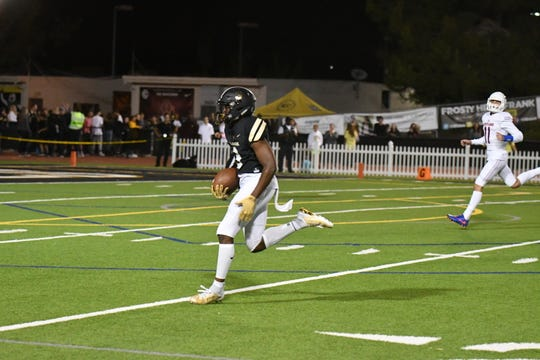 Calabasas High's Larry Turner-Gooden returns a punt for a touchdown during the Coyotes' 54-35 victory over Westlake in a Marmonte League game Friday night.