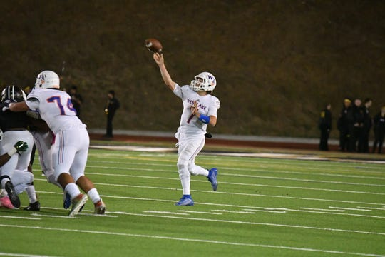 Westlake High quarterback Marco Siderman fires a touchdown pass during the Warriors' 54-35 loss at Calabasas on Friday night.