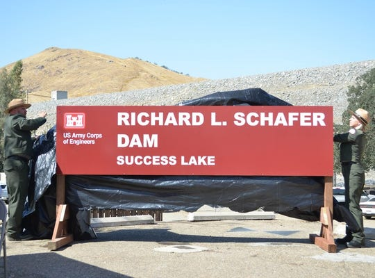 Two rangers from the U.S. Army Corps of Engineers, Sacramento District, unveil a sign bearing the new name of the former Success Dam during a renaming ceremony at Lake Success on Oct. 1, 2019. The dam's name was changed to the Richard L. Schafer Dam following a congressional resolution authored by Rep. Kevin McCarthy and signed into law by President Donald Trump Aug. 9, 2019.