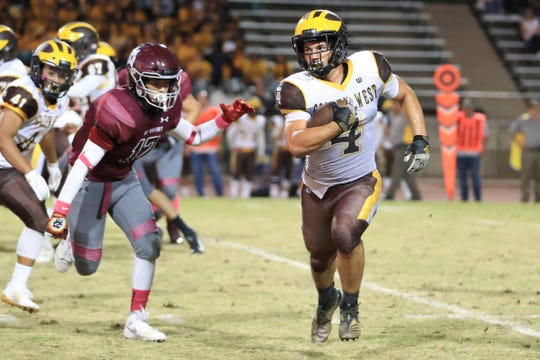 Golden West's Lonnie Wessel (4) rushes against Mt Whitney  in a West Yosemite League High School Football game at Visalia Mineral King Bowl on Friday, Oct 4th, 2019.