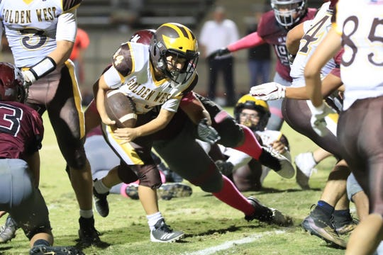 Golden West's Angel Celaya (44) rushes against Mt Whitney in a West Yosemite League High School Football game at Visalia Mineral King Bowl on Friday, Oct 4th, 2019.