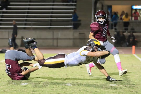 Golden West's Lonnie Wessel (4) dives toward end zone against Mt Whitney in a West Yosemite League High School Football game at Visalia Mineral King Bowl on Friday, Oct 4th, 2019.