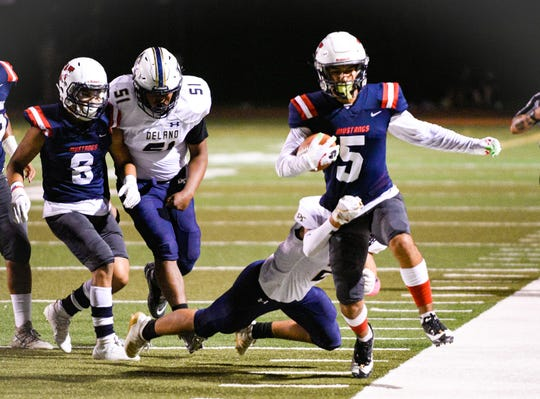 Tulare Western's Mikey Ficher gains yards against Delano in an East Yosemite League football game on Friday, Oct. 4, 2019.