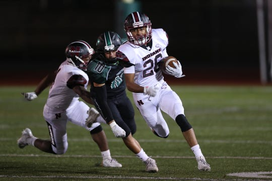 Nyack's Keshawn Evans (26) looks for some running room in the Yorktown defense as he runs for a big gain during football action at Yorktown High School Oct. 4, 2019.