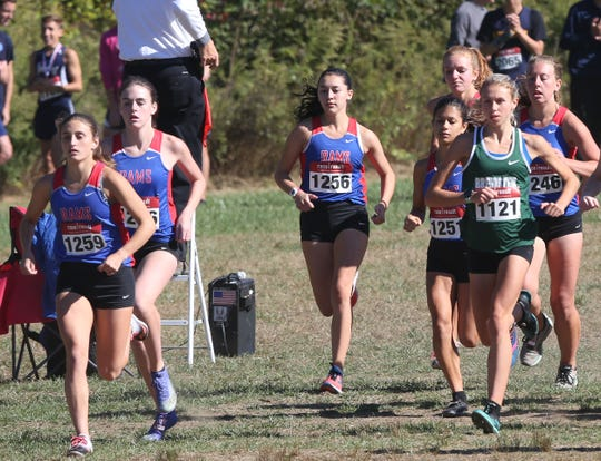 Carmel and Brewster at the start of the girls Varsity Division 1 race at the annual Brewster Bear Classic at Brewster High School 