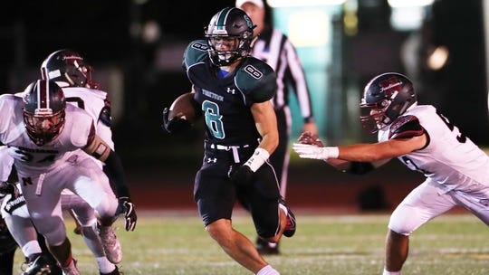 Yorktown's Dylan Smith (8) looks for some running room in the Nyack defense during football action at Yorktown High School Oct. 4, 2019.