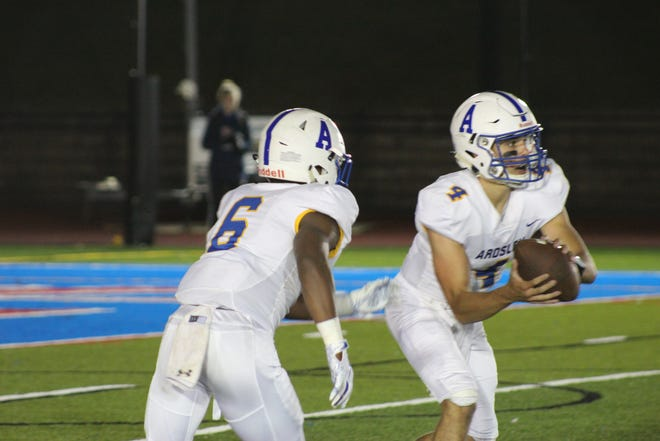 Ardsley quarterback Luke Mantini takes the snap, with running back Jalen Osbourne next to him, during a football game against Byram Hills at Byram Hills High School on Friday, October 4th, 2019.