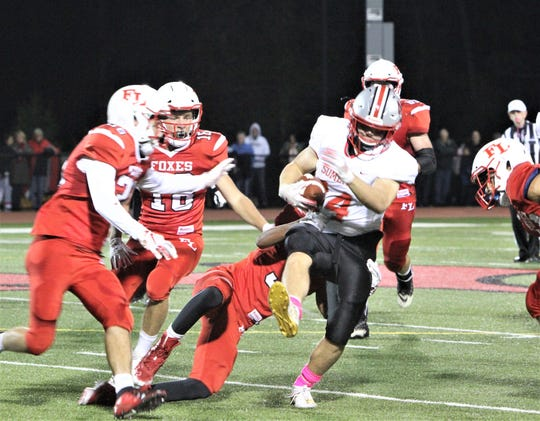Somers' Jack Kaiser tries to break tackle by Fox Lane's Thomas Olsen.