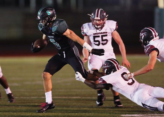 Yorktown's Dylan Smith (8) breaks a few tackles as he looks for some running room in the Nyack defense during football action at Yorktown High School Oct. 4, 2019.