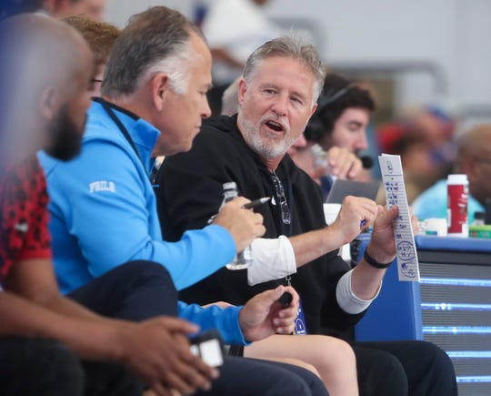 Sixers head coach Brett Brown watches from midcourt during the Sixers' Blue-White Scrimmage at the 76ers Fieldhouse in Wilmington Saturday.