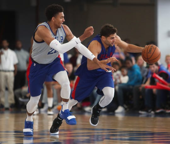 Sixers Matisse Thybulle (left) and Raul Meto break up court during the Sixers' Blue-White Scrimmage at the 76ers Fieldhouse in Wilmington Saturday.