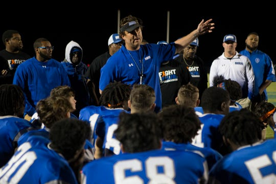 Woodbridge head coach Jed Bell, center, speaks to his team after defeating Archmere 27-0 Friday night.