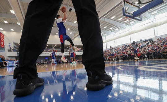 Sixer Ben Simmons is framed by a referee's legs as he shoots during the Sixers' Blue-White Scrimmage at the 76ers Fieldhouse in Wilmington Saturday.