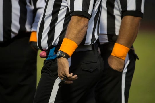 Orange wristbands were worn in memory of Troy Haynes by the referees for Woodbridge's Friday night game against Archmere.