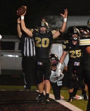 Henrietta receiver Reece Essler (20) celebrates his third touchdown of the game Friday night against Nocona in Henrietta.