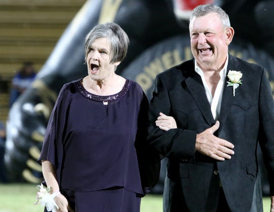 Janis Everson stands with her husband after being honored on the 50th anniversary of being crowned Crowell's homecoming queen Friday, Oct. 5, 2019, in Crowell.