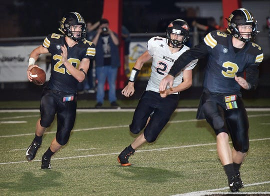 Henrietta's Reece Essler looks downfield for a receiver while running a flea flicker play agains the Nocona Indians Friday night in Henrietta. Nocona's Jason Sparkman (21) pursues on the play as quarterback Jonah Lyde (3) leads the play.