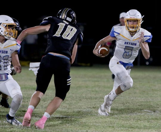 Bryson's Landon Stevens runs for a first down against Crowell Friday, Oct. 5, 2019, in Crowell. The Cowboys defeated the Wildcats 54-48.