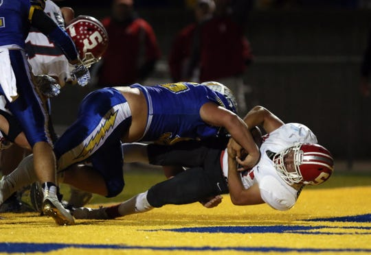 Sheridan's Jason Munyan tumbles into the endzone against Philo Friday night in Duncan Falls. Sheridan beat the Electrics 21-19.