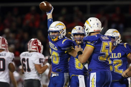 Philo celebrates Colt Perkin's strip of Sheridan quarterback Nathan Johnson.