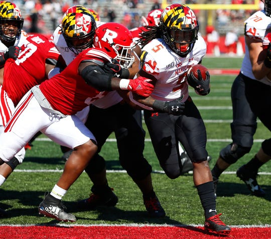 Maryland running back Anthony McFarland Jr. rushes for a touchdown against Rutgers during the first half at SHi Stadium.