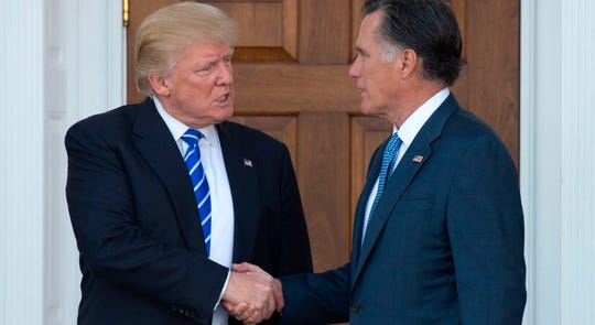 Then-President-elect Donald Trump shakes hands with Mitt Romney after their meeting at the clubhouse of Trump National Golf Club in Bedminster, New Jersey, Jan. 1, 2019.
