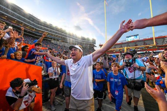 Florida Gators head coach Dan Mullen walks off the field after defeating the Auburn Tigers at Ben Hill Griffin Stadium.
