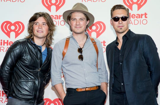 Zac, Taylor and Isaac Hanson, arrive at the iHeartRadio Music Festival on Sept. 21, 2013 in Las Vegas.