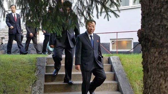 A handout photo made available by the Joint Press Corps shows North Korean delegates, including top negotiator Kim Myong-gil, leaving the North Korean embassy in Stockholm, Oct. 5, 2019, to attend a meeting with U.S. officials.