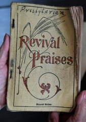 A book of Christian revival hymns published in 1907, held by Nicki Harle and found in a time capsule placed inside the cornerstone of the Baird First Presbyterian Church over a century ago, Thursday Oct. 3, 2019.