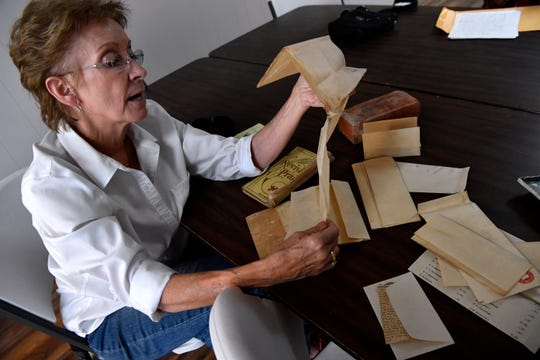 Nicki Harle, the treasurer for Baird First Presbyterian Church, leafs through pages Thursday which were found earlier this year stored in a time capsule in the church's 1919 cornerstone, Oct. 5, 2019. The church has been undergoing renovation to its outer brick layer.