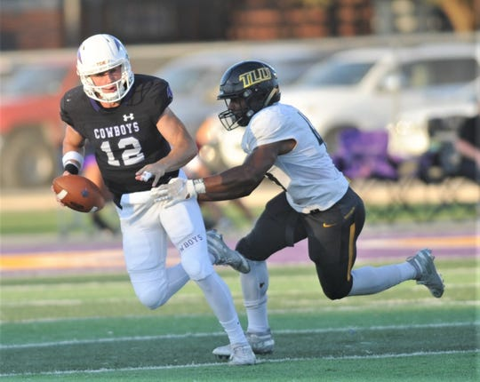 A Texas Lutheran defender gets pressure on HSU quarterback Brennen Wooten during their American Southwest Conference game Saturday at Shelton Stadium.