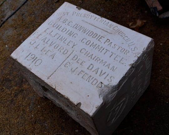 The 1910 cornerstone of the Baird First Presbyterian Church Thursday Oct. 3, 2019. A time capsule was found inside earlier this year containing documents from the congregation's founding.