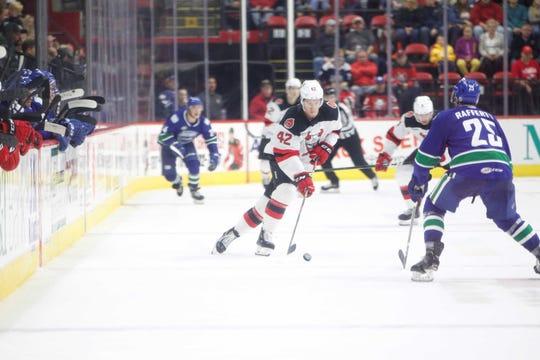 Binghamton Devils forward Nathan Bastian carries the puck down the ice at Floyd L. Maines Veterans Memorial Arena Saturday, October 5, 2019.