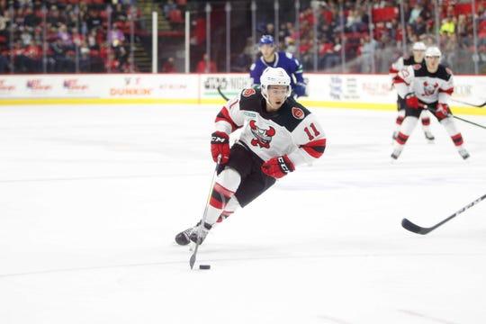 Binghamton Devils forward Brett Seney carries the puck toward the Utica net at Floyd L. Maines Veterans Memorial Arena Saturday, October 5, 2019.