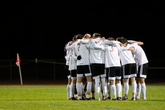 CVU huddles together during the high school boys soccer game between the Champlain Valley Union Redhawks and the Essex Hornets at Essex High School on Saturday night October 5, 2019 in Essex, Vermont.
